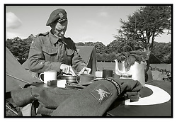 Rufford Abbey 1940's Weekend<br /> Reenactor Portrait - A member of the 1st British Airborne Division (1st Allied Airborne Corps) eats a lunch using the bonnet of a Willys Jeep as a table<br /> <br />  30 September 2017 <br />   Copyright Paul David Drabble<br />   www.pauldaviddrabble.co.uk