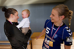 Jelena Grubisic and Barbara Varlec Lazovic of Krim with her son Luka (C) after the last game of 1st A Slovenian Women Handball League season 2011/12 between ZRK Krka and RK Krim Mercator, on May 8, 2012 in Stopice at Novo mesto, Slovenia. RK Krim Mercator became Slovenian National Champion, GEN-I Zagorje placed second and ZRK Krka placed third. (Photo by Vid Ponikvar / Sportida.com)