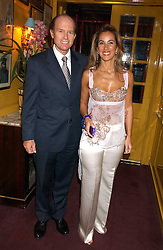 MR & MRS ANDREAS TSAVLIRIS at a dinner hosted by Stratis & Maria Hatzistefanis at Annabel's, Berkeley Square, London on 24th March 2006 following the christening of their son earlier in the day.<br /><br />NON EXCLUSIVE - WORLD RIGHTS