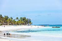 Kendwa, Zanzibar-March 4, 2019 :people tourist enjoying vacantions walking on the beach and bathing