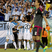 FOXBOROUGH, MASSACHUSETTS - JUNE 18:  Lionel Messi #10 of Argentina is congratulated after scoring by team mates Gonzalo Higuain #9, Ever Banega #19 and Nicolas Gaitan #20 of Argentina during the Argentina Vs Venezuela Quarterfinal match of the Copa America Centenario USA 2016 Tournament at Gillette Stadium on June 18, 2016 in Foxborough, Massachusetts. (Photo by Tim Clayton/Corbis via Getty Images)