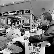 Y-720418-12. McDonalds, Union & Fremont. Voter registration drive. Nate Proby administering oath.(president, United Minority Workers),  Voter is Francis Newman. April 18, 1972
