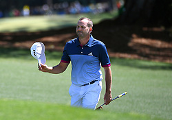 Sergio Garcia tips his cap to the gallery as he walks to the 18th green during the second round of the Masters Tournament at Augusta National Golf Club in Augusta, Ga., on Friday, April 7, 2017. (Photo by Jeff Siner/Charlotte Observer/TNS)  *** Please Use Credit from Credit Field ***