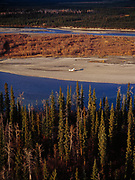 Aerial photograph of Andy Greenblatt's Piper Super Cub on gravel bar of the North Fork of the Koyukuk River southwest of Bettles, Alaska.