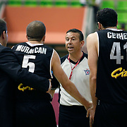 Referee's Engin KENNERMAN (C) during their Turkish Basketball league Play Off semi final first match Efes Pilsen between Besiktas at the Ayhan Sahenk Arena in Istanbul Turkey on Sunday 09 May 2010. Photo by Aykut AKICI/TURKPIX