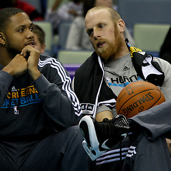 December 17, 2011; New Orleans, LA, USA; New Orleans Hornets guard Eric Gordon and center Chris Kaman watch from the bench during a scrimmage at the New Orleans Arena.   Mandatory Credit: Derick E. Hingle-US PRESSWIRE