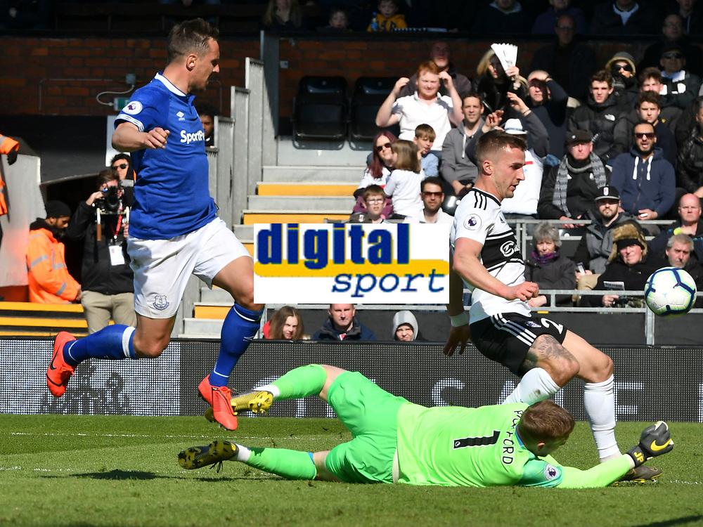 Football - 2018 / 2019 Premier League - Fulham vs. Everton<br /> <br /> Jordan Pickford Everton saves an attempt from Joe Bryan Fulham, at Craven Cottage.<br /> <br /> COLORSPORT/WINSTON BYNORTH