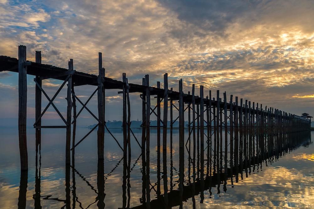 Sunrise in the U Bein Bridge in Amarpura in the Mandalay Region in Myanmar