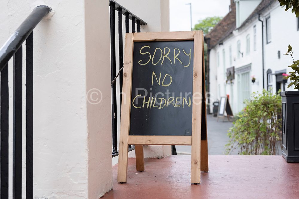 Sorry no children sign outside a pub on 21st July 2020 in Much Wenlock, United Kingdom. Pubs were originally known as adult places, but in recent years have become far more family orientated, much to the displeasure of some people who believe they are no place for under 18s.