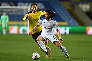 Tranmere Rovers midfielder (on loan from Crystal Palace) Nya Kirby (16) controls the ball under pressure from Oxford United midfielder James Henry (17) during the EFL Trophy match between Oxford United and Tranmere Rovers at the Kassam Stadium, Oxford, England on 16 February 2021.