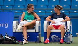 September 22, 2018 - Daria Kasatkina of Russia & Kirsten Flipkens of Belgium during a practice break at the 2018 Dongfeng Motor Wuhan Open WTA Premier 5 tennis tournament (Credit Image: © AFP7 via ZUMA Wire)