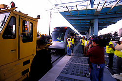 Houston Metro workers working on the light rail train
