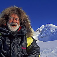 ANTARCTICA, Mount Vaughan Expedition. 88-year old Norman Vaughan below 10,302' Mount Vaughan, located less than 300 miles from South Pole and named for Norman in 1929 by explorer Richard Byrd. Norman climbed the peak in December 1994, 2 days shy of his 89th birthday.