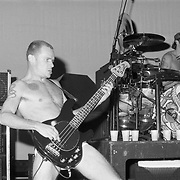 STANHOPE - AUGUST 11: Bassist Flea of Red Hot Chili Peppers performs during Lollapalooza at Waterloo Village on August 11, 1992 in Stanhope, New Jersey. ©Lisa Lake