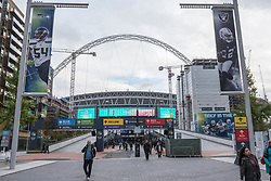 © Licensed to London News Pictures. 17/10/2018. LONDON, UK.  A general view of Wembley Stadium as seen from Olympic Way.  The area is currently decorated with NFL branding to promote the current three game series of NFL games at the stadium.  Shahid Khan, owner of Fulham FC and the Jacksonville Jaguars NFL team, has withdrawn his £600m offer to buy the stadium, amidst reports that he did not feel that he would receive sufficient support from The Football Association (FA).  The FA was due to vote on the potential sale on October 24.  Photo credit: Stephen Chung/LNP