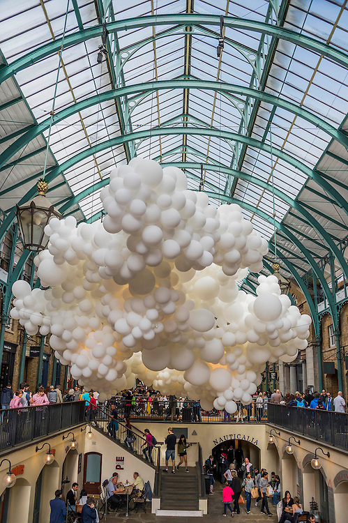 Heartbeat - French artist Charles Pétillon's first public art installation (and his first ever live work outside of France) in Covent Garden. 100,000 giant white balloons fill the grand interior of the 19th Century Market Building. Heartbeat stretches 54 metres in length and 12 metres in width, and incorporates gentle pulsating white light to symbolise the beating of a heart and reflect the history, energy and dynamism of the district. The complex yet fragile composition represents Charles' largest and most ambitious project to date and will run from 27th August until 27th September. Charles is best known for Invasions, a series of arresting sculptures which challenge perceptions of everyday scenes by filling the likes of derelict houses, basketball courts and even cars with hundreds of white balloons.