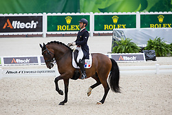 Arnaud Serre, (FRA), Robinson De Lafont De Massa - Grand Prix Team Competition Dressage - Alltech FEI World Equestrian Games™ 2014 - Normandy, France.<br /> © Hippo Foto Team - Leanjo de Koster<br /> 25/06/14