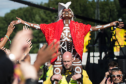 © Licensed to London News Pictures . 07/06/2015 . Manchester , UK . GRACE JONES is carried alongside the crowd on the shoulders of a security guard as she performs on the main stage at The Parklife 2015 music festival in Heaton Park , Manchester . Photo credit : Joel Goodman/LNP