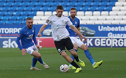 Steven Rigg of Dover Athletic in action with Dan Butler and Mark Beevers of Peterborough United - Mandatory by-line: Joe Dent/JMP - 01/12/2019 - FOOTBALL - Weston Homes Stadium - Peterborough, England - Peterborough United v Dover Athletic - Emirates FA Cup second round