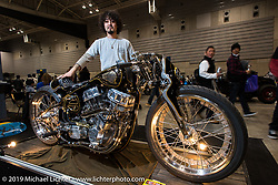 Cherry's Company Kaichiroh Kurosu with his first place winning bike at the Annual Mooneyes Yokohama Hot Rod and Custom Show. Japan. Sunday, December 7, 2014. Photograph ©2014 Michael Lichter.