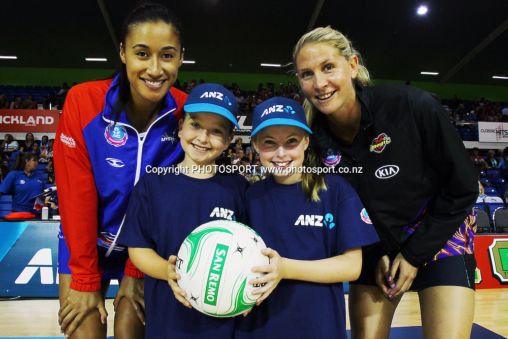 ANZ Future Captains Brair Geange aged 10 (L) and Brianna Jolly aged 9 (R) with Mystics' Captain Maria Tutaia and Magic's Captain Casey Kopua. ANZ Netball Championship, Northern Mystics v WBOP Magic, Trusts Stadium, Auckland, New Zealand. Monday 10th March 2014. Photo: Anthony Au-Yeung / photosport.co.nz