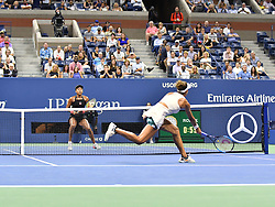 September 6, 2018 - Flushing Meadow, NY, U.S. - FLUSHING MEADOW, NY - SEPTEMBER 06:  Madison Keys (USA) stretches for a wide volley as Naomi Osaka (JPN) waits to hit a return, during  their semi-final match in the Women's Singles Championships at the US Open on September 06, 2018, at the Billie Jean King Tennis Center in Flushing Meadow, NY. (Photo by Cynthia Lum/Icon Sportswire) (Credit Image: © Cynthia Lum/Icon SMI via ZUMA Press)