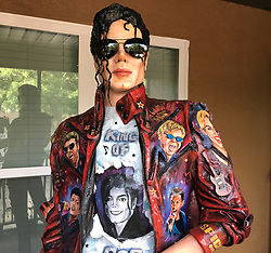 "EXCLUSIVE: VIDEO AVAILABLE TOO. Artist, Cristiam Ramos has paid tribute to the up-coming anniversary of the death of Michael Jackson on June 25. He has created a life-size sculpture of the king of pop which will be exhibited at Hard Rock in Orlando and various other places around America. The unique sculpture contains more than 40 portraits of pop singers painted on it. Ramos has been a fan of the late Jackson since he was a child and he wanted to pay tribute to the legend in a unique and special way. ""This sculpture is not just a tribute to Michael Jackson, it is a tribute to all pop music. It contains more than 40 portraits of the most popular pop singers, like Justin Bieber, Miley Cyrus, Bruno Mars, Katy Perry, Lady Gaga, Ariana Grande and more"" says Ramos.The statue took Ramos four months to create, working 10 hours a day. It is made from sculpting clay and the portraits are painted on with oil and acrylic paint. Always a busy man, Ramos is already working on this next project: classic masterpieces painted on the wings of real butterflies. Stay tuned…. 07 May 2017 Pictured: Cristiam Ramos, Michael Jackson. Photo credit: IMP Features / MEGA TheMegaAgency.com +1 888 505 6342"