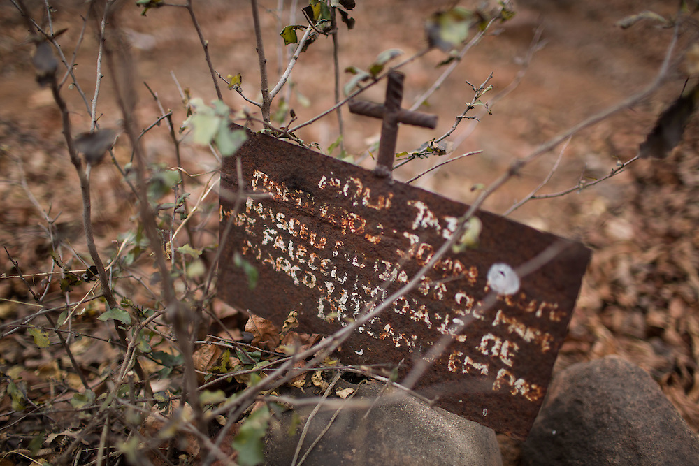 Chipanga, Tete province, Mozambique. The cemetery of Chipanga is also to be removed and bodies will be exhumed. The first relocated bones have been mysteriously lost ?..Over 700 families from the villages of Chipanga, Mitete, Malabue-Gombe and Bagamoyo were resettled to Cateme village, a Vale resettlement compound. Vale deliberately divided the communities in two with employed villagers moving to 25 de Setembro since it is closer to Moatize and the coal mine. The unemployed were resettled to Cateme, 40 km from the original town. While the most immediate problem of the community is the enormous distance to Moatize, their old habitat, they also suffer from unproductive farmland which can only be reached via a two hour walk, no access to markets and infrastructure and poorly constructed houses not fitted to the people's needs with temperatures inside reaching as high as 65° C due to the construction with tin clad roofs and missing isolation.