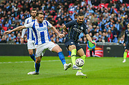 Brighton & Hove Albion midfielder Dale Stephens (6) and Manchester City midfielder Ilkay Gundogan (8) during the The FA Cup semi-final match between Manchester City and Brighton and Hove Albion at Wembley Stadium, London, England on 6 April 2019.