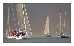 Yachting- The first days inshore racing  of the Bell Lawrie Scottish series 2003 at Tarbert Loch Fyne.  Light shifty winds dominated the racing...Swan 45 Crackerjack practices upwind at the end of a Rainbow...Pics Marc Turner / PFM