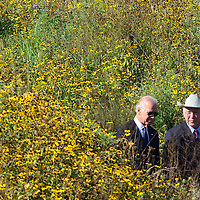 Vice President Joseph Biden and Secretary of the Interior Ken Salazar walk through a field of Black-Eyed Susan and other wildflowers as they approach the  Flight 93 National Memorial on September 11, 2012  near Shanksville, PA.  This is the 11th anniversary of the terrorist attack against the United States.  UPI/Archie Carpenter