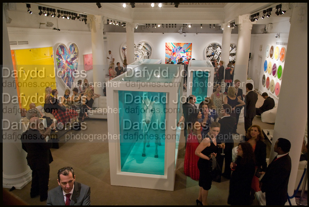 DAMIEN HIRST; DASHA ZHUKOVA, Damien Hirst party to preview his exhibition at Sotheby's. New Bond St. London. 12 September 2008 *** Local Caption *** -DO NOT ARCHIVE-© Copyright Photograph by Dafydd Jones. 248 Clapham Rd. London SW9 0PZ. Tel 0207 820 0771. www.dafjones.com.<br /> DAMIEN HIRST; DASHA ZHUKOVA, Damien Hirst party to preview his exhibition at Sotheby's. New Bond St. London. 12 September 2008