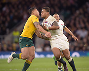 Twickenham, United Kingdom. {R} Nathan HUGHES applies the hand off to Israel FOLAU, during the Old Mutual Wealth Series Rest Match: England vs Australia, at the RFU Stadium, Twickenham, England, <br /> <br /> Saturday  03/12/2016<br /> <br /> [Mandatory Credit; Peter Spurrier/Intersport-images]