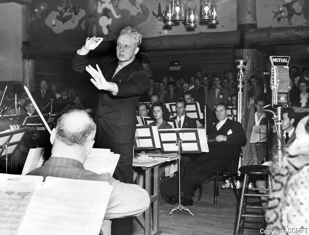 10/31/43 Leopold Stokowski conducts an 80- piece orchestra during the Hollywood Canteen's first birthday party.