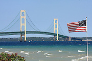 This image captures the Mackinac Bridge from Huron Street in Mackinaw City, Michigan, on a blustery day in early July, 2013. I just couldn't resist the temptation to frame up this shot with the American flag.