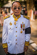 """04 FEBRUARY 2013 - PHNOM PENH, CAMBODIA: A Cambodian government official in his official mourning uniform makes his way to the cremation of King-Father Norodom Sihanouk in Phnom Penh. Norodom Sihanouk (31 October 1922- 15 October 2012) was the King of Cambodia from 1941 to 1955 and again from 1993 to 2004. He was the effective ruler of Cambodia from 1953 to 1970. After his second abdication in 2004, he was given the honorific of """"The King-Father of Cambodia."""" Sihanouk died in Beijing, China, where he was receiving medical care, on Oct. 15, 2012.    PHOTO BY JACK KURTZ"""