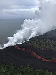 """Handout photo taken on May 21, 2018 of KÄ«lauea Volcano — Laze. Lava continues to enter the sea at two locations this morning. During this morning's overflight, the wind was blowing the """"laze"""" plumes along the shoreline toward the southwest. Photo by usgs via ABACAPRESS.COM"""