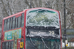 © Licensed to London News Pictures. 24/01/2021. London, UK. A bus covered in snow travellers in north London as large parts of the UK are expected to be blanketed in snow and freezing conditions. According to the Met Office, the cold weather could bring up to 10cm of snow to some parts of the country and an amber weather warning for snow and ice is in place across much of the UK. Photo credit: Dinendra Haria/LNP