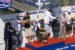 Medemblik - the Netherlands, May 31th 2009. Delta Lloyd Regatta in Medemblik (27/31 May 2009). Day 5, Medal races. The winners of all classes with champagne on the podium.