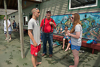 Armando Bona shares stories of working at the pool during the 1950's with lifeguards Joe Ambroz and Katelynb Tomaselli at the 70th Anniversary celebration of the Kiwanis Pool in St. Johnsbury Vermont.  Karen Bobotas / for Kiwanis International