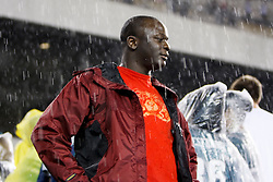 8 August 2008: A Philadelphia Eagles fan watches in the pouring rain as the team retreats back into the locker room during the game against the Carolina Panthers on August 14, 2008. The Game had a rain delay  of approximately 45 minutes. The Eagles beat the Panthers 24 to 13 at Lincoln Financial Field in Phialdelphia, Pennsylvania. (Photo by Brian Garfinkel)