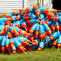 Colorful lobster bouys stacked for a new season.