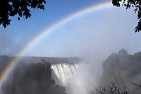 The Victoria Falls or Mosi-o-Tunya (the Smoke that Thunders) is a waterfall located in southern Africa on the Zambezi River between the countries of Zambia and Zimbabwe. The falls are the largest in the world.....The Victoria falls is 1 708 meters wide, making it the largest curtain of water in the world. It drops between 90m and 107m into the Zambezi Gorge and an average of 550,000 cubic metres of water plummet over the edge every minute.....Remarkably preserved in its natural state, Victoria falls inspires visitors as much today as it did David Livingstone in the 1860's. The falls and the surrounding area have been declared National Parks and a World Heritage Site, thus preserving the area from excessive commercialisation.