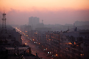 A view of the hazy city skyline at sunrise in Linfen, Shanxi Province, China on Thursday, 03 December, 2009.  Due to the heavy presence of coal mines and related industries, Linfen was named the world's most polluted city from 2004-2007.