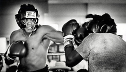 June 3, 2016 - File - MUHAMMAD ALI, the three time heavyweight boxing champion, has died at the age of 74. He had been fighting a respiratory illness. Pictured: 1970 - Florida, U.S. - Undated photo: Muhammad Ali shows his determination in this image from a sparring session. (Credit Image: © The Palm Beach Post via ZUMA Wire)