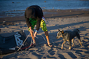 Fernando Gomez and his dog Chano prepares kite for launch at Hood River, Oregon