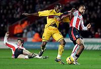 Photo: Alan Crowhurst.<br />Southampton v Burnley. Coca Cola Championship. 13/01/2007. Saints David McGoldrick (R) challenges with Eric Djemba-Djemba.