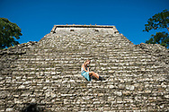 Chloe, from Australia, at the Mayan ruins in Palenque, Chiapas, Mexico. The Mayan city-state flourished in the 7th century.