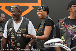 """Terri Collins with other members of the Flying Eagles MC of Baltimore at """"Biking on the Boulevard"""" on Dr. Mary McLeod Bethune Blvd during Daytona Bike Week 75th Anniversary event. FL, USA. Friday March 11, 2016.  Photography ©2016 Michael Lichter."""