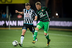 (L-R) Tim Breukers of Heracles Almelo, Sam Larsson of Feyenoord during the Dutch Eredivisie match between Heracles Almelo and Feyenoord Rotterdam at Polman stadium on September 09, 2017 in Almelo, The Netherlands